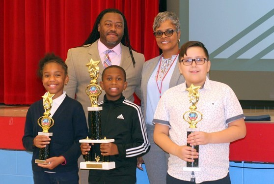 Winners (Egypt Drayton - 3rd pl., Kameron Facen -1st pl. & Christian Solorio - 2nd pl.) receive their awards at the Annual District Social Studies Fair.