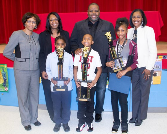 School Principals, Dr. Trotter & Dr. Levy, Board President Dean Barnett & District Superintendent Dr. Williams present trophies to District Science Fair Winners (Gary Bradley - 2nd place, Kameron Facen - 1st place & Omayah Stubbs - 3rd place)