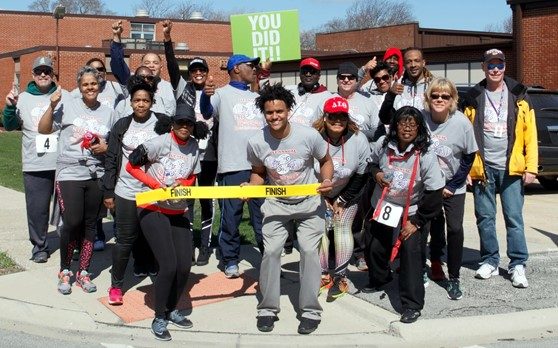 Participants of the 1st Annual Wellness 5K Walk/Run pause for photos after completion the event.