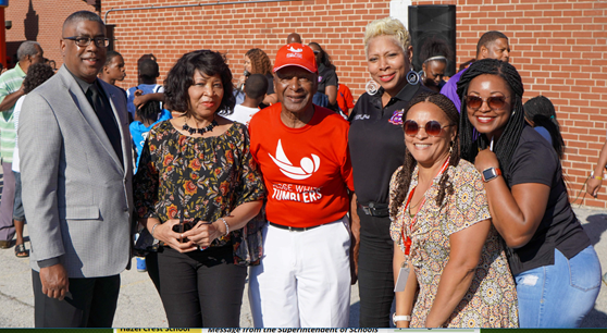 Superintendent Spells, Secretary of State Jesse White and district staff enjoy the Annual Back to School Bash