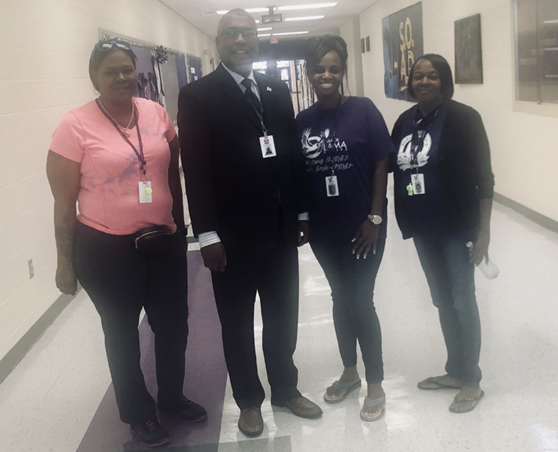 Superintendent Spells with lunchroom staff (Ms. Jones, Ms. Phillips & Ms. Mack) at Barack Obama Learning Academy.