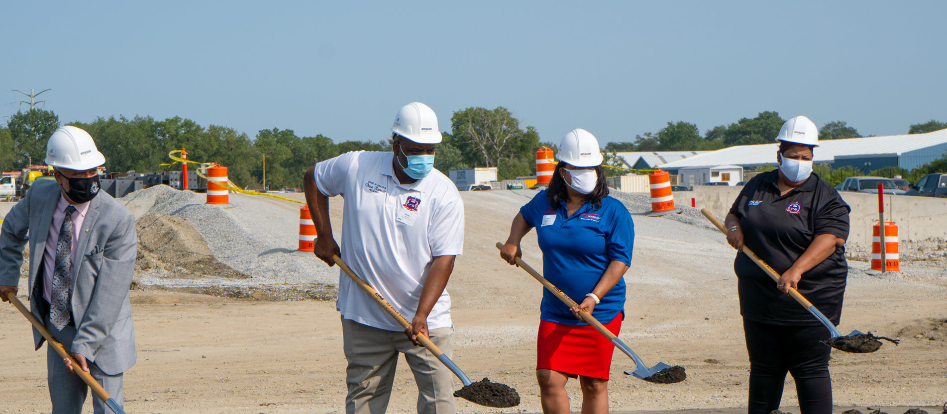 School Board President Dean Barnett (in white) and board member Kimberly Chalmers (in black) at the recent Amazon Fulfillment Center Groundbreaking ceremony
