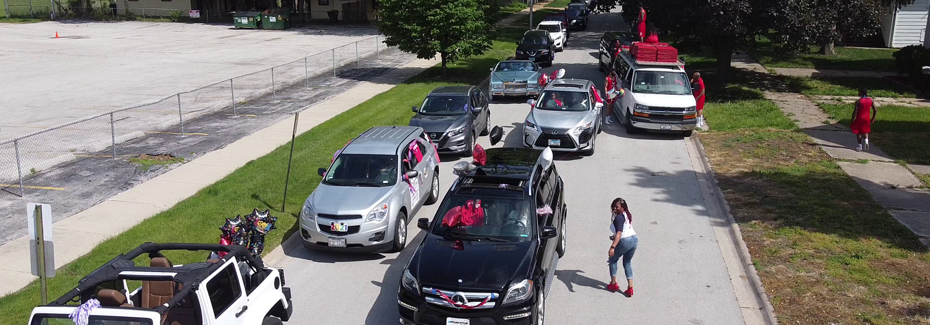 HCSD staff cars line up in preparation for the 2nd Annual Community Parade